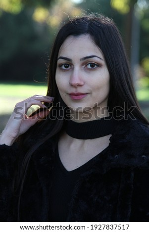 Middle Eastern girl in a park Royalty-Free Stock Photo #1927837517