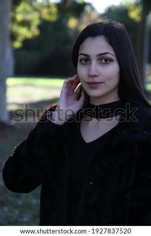 Middle Eastern girl in a park Royalty-Free Stock Photo #1927837520