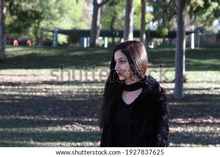Middle Eastern girl in a park Royalty-Free Stock Photo #1927837625