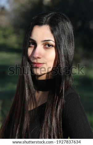 Middle Eastern girl in a park Royalty-Free Stock Photo #1927837634