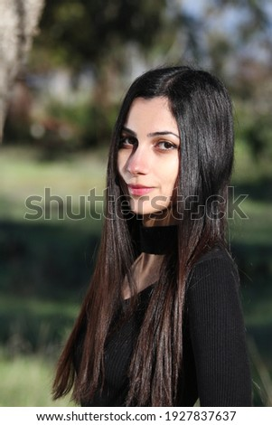 Middle Eastern girl in a park Royalty-Free Stock Photo #1927837637