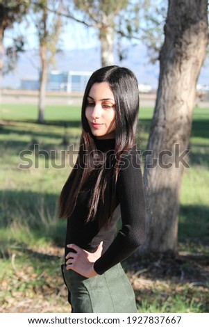 Middle Eastern girl in a park Royalty-Free Stock Photo #1927837667