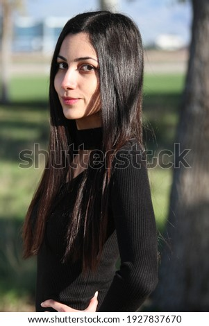 Middle Eastern girl in a park Royalty-Free Stock Photo #1927837670