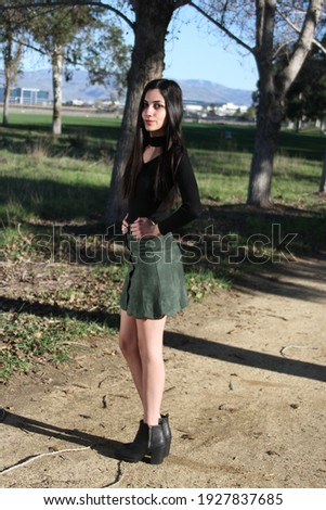 Middle Eastern girl in a park Royalty-Free Stock Photo #1927837685
