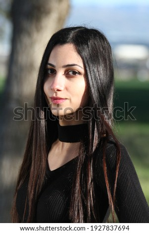 Middle Eastern girl in a park Royalty-Free Stock Photo #1927837694