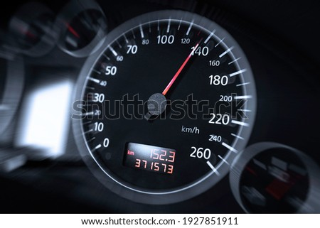 The speedometer of a modern car shows a high driving speed. Added motion blur. Royalty-Free Stock Photo #1927851911