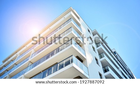 Apartment residential house and home facade architecture and outdoor facilities. Blue sky on the background. Sunlight in sunrise. Royalty-Free Stock Photo #1927887092