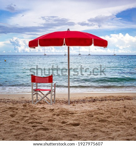 Lifeguard Chair and parasol at empty beach of Fetovaia, Island of Elba, Tuscany, Italy; swimmers rescue and safety concept Royalty-Free Stock Photo #1927975607