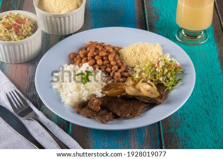 Traditional Brazilian food dish tasty homemade lunch. Royalty-Free Stock Photo #1928019077