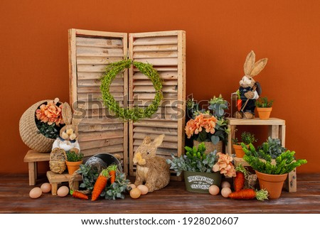 Easter backdrop or background for photo mini session in brown color. Contains straw rabbits. Royalty-Free Stock Photo #1928020607