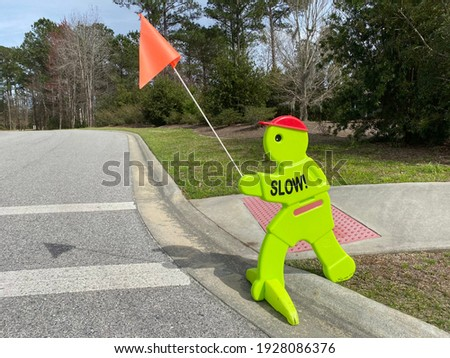 Slow sign at school areas to warn drivers to slow down! Royalty-Free Stock Photo #1928086376