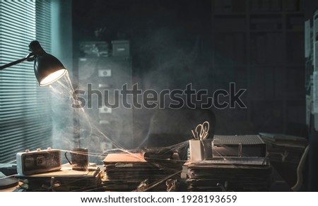 Messy abandoned office after company shut down: the desk is cluttered and dusty, financial crisis concept Royalty-Free Stock Photo #1928193659