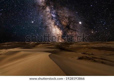 Amazing views of desert under the night starry sky. in the Arabian Empty Quarter Desert, UAE. Rub' al Khali Royalty-Free Stock Photo #1928193866