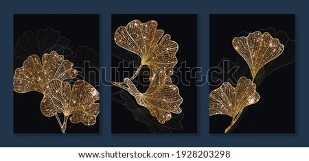 Luxury gold Ginkgo Biloba Leaf background.  Black and golden wall art design with dark blue and green color, shiny golden line arts light texture. Modern art mural wallpaper.  Royalty-Free Stock Photo #1928203298
