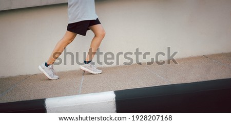 Hiit workout cardio running jogging up the Slope road way training. Slope climbing run woman going run up steps. Runner athlete doing cardio sport workout. Royalty-Free Stock Photo #1928207168