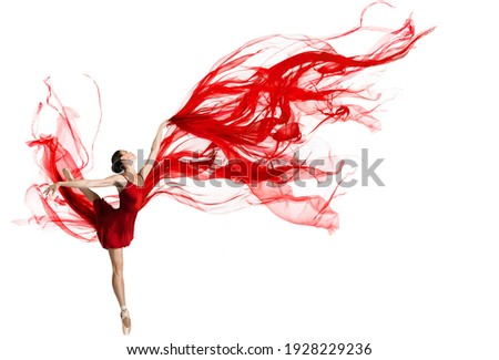Ballerina Dance. Woman dancing Red Fabric. Graceful Ballet Dancer jumping in Air. Red Cloth flying waving on Wind. Isolated White Background Royalty-Free Stock Photo #1928229236