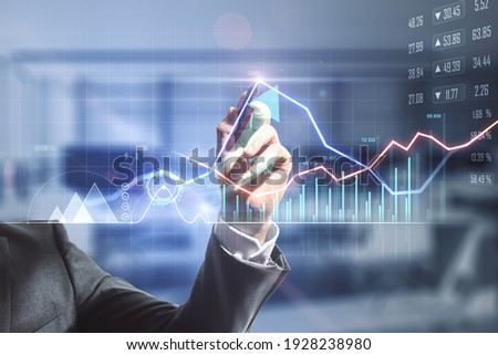 Businessman hand writing on digital screen with financial trade market graphs, diagram and forex chart. Double exposure Royalty-Free Stock Photo #1928238980