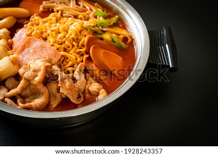 Budae Jjigae or Budaejjigae (Army stew or Army base stew). It is loaded with Kimchi, spam, sausages, ramen noodles and much more - popular Korean hot pot food style Royalty-Free Stock Photo #1928243357