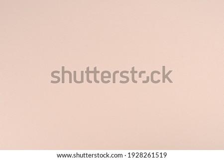 Pale rose paper background. Coconut white colour paper texture. Matte monochrome surface.