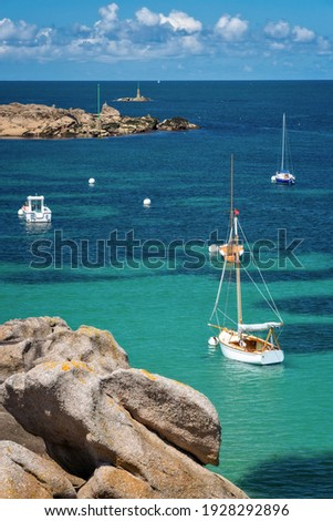 Sailing Boats and transparent water on Coz-Pors beach in Tregastel, Côtes d'Armor, Brittany, France Royalty-Free Stock Photo #1928292896