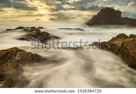 Long exposure water, beautiful seascape, ocean views, rocky coastline, sunlight, on the horizon. Composition of nature. Sunset scenery background. Cloudy sky. California coast. Royalty-Free Stock Photo #1928384720