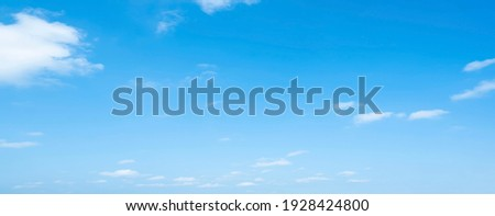 Air clouds in the blue sky.blue backdrop in the air. abstract style for text, design, fashion, agencies, websites, bloggers, publications, online marketers, brand, pattern, model, animation, Royalty-Free Stock Photo #1928424800