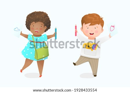 Little girl and boy drawing with pencil on paper, happy African American kid smiling showing illustration on paper. Preschooler, kindregarten or elementary school drawing.