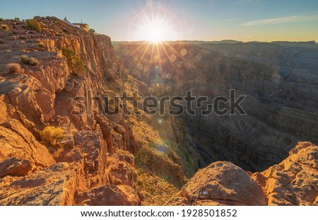 Beautiful landscapes of the Grand Canyon, an amazing view of the sunset over the red-orange rocks that are millions of years old. USA, Arizona. Royalty-Free Stock Photo #1928501852