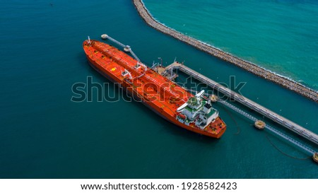 Aerial view industrial crude oil and fuel tanker ship at deep ocean sea port, Tanker ship vessel at terminal port, Business import export oil and gas petrochemical by tanker ship transportation oil. Royalty-Free Stock Photo #1928582423