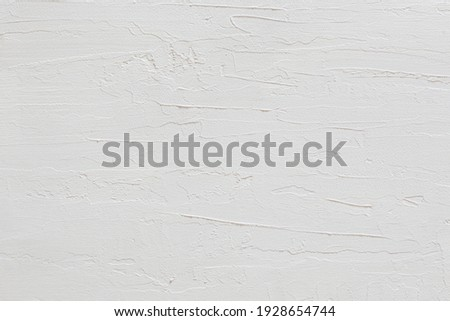 close-up view of a white stucco wall texture Royalty-Free Stock Photo #1928654744