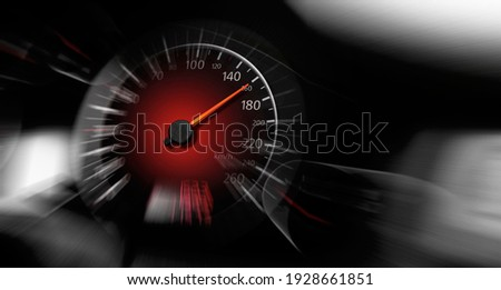 The speedometer of a modern car shows a high driving speed. Added motion blur. Royalty-Free Stock Photo #1928661851