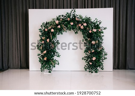 Beautiful wedding ceremony design decoration elements with arch, floral design, flowers. Royalty-Free Stock Photo #1928700752