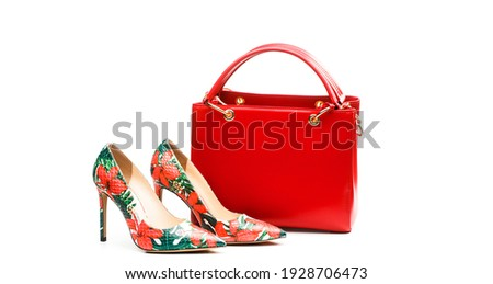 High heel women shoes and a bags. Stylish red women's leather sandals shoes. Woman bag. Ladies bag and stylish red shoes. Colorful leather shoes stiletto. Stylish classic women leather shoe. Royalty-Free Stock Photo #1928706473