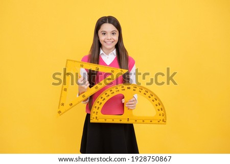 cheerful teen girl study math with protractor and triangle measuring size, back to school.