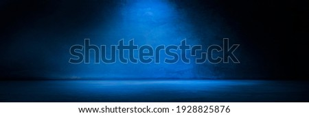 Blue concrete wall and floor with light and shadow backgrounds, use for product display for presentation and cover banner design. Royalty-Free Stock Photo #1928825876