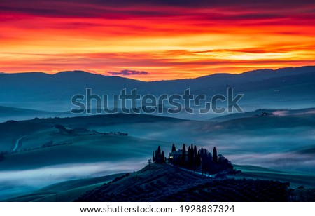 Mountain valley in sunset fog. Sunset fog mountain valley. Valley in fog at sunset. Sunset fog valley landscape Royalty-Free Stock Photo #1928837324