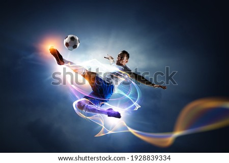 Soccer player on stadium in action. Mixed media Royalty-Free Stock Photo #1928839334