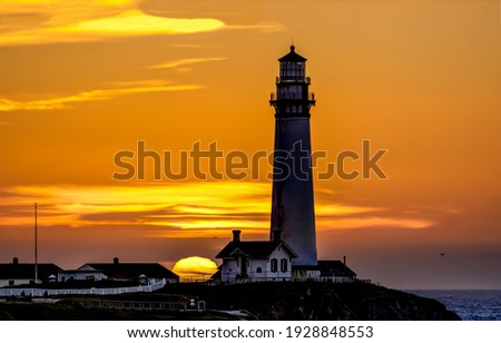 Sunset lighthouse silhouette. Lighthouse at sunset. Sunset lighthouse silhouette view. Lighthouse sunset scene Royalty-Free Stock Photo #1928848553