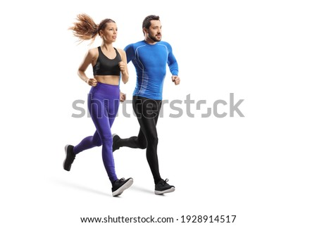 Full length shot of a young man and woman in sportswear running together isolated on white background Royalty-Free Stock Photo #1928914517