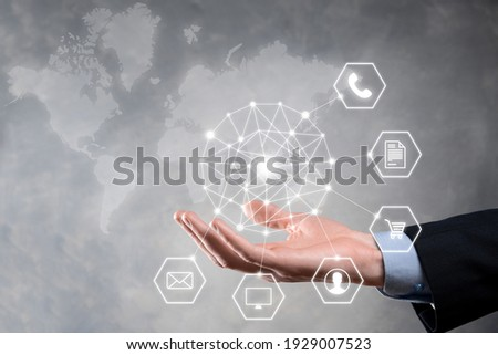 Business concept Close up of man using mobile smart phone and infographic icon of community technology digital.Concept of hi tech and big data. Toned image.