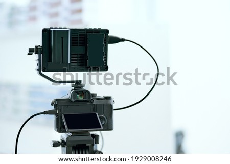 Dslr camera with additional screen for video shooting .