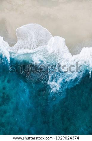 The waves crashing on the beach Royalty-Free Stock Photo #1929024374