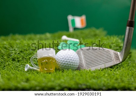 Golf ball for St. Patrick's Day is on green grass