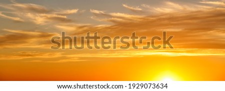 Dramatic colorful clouds with the sun in the sky. Panoramic view