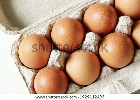 brown hen eggs in carton box Royalty-Free Stock Photo #1929112493