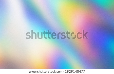 rainbow grainy gradient background texture. blurred multicolor design with the soft noise on top. colorful abstract art background for vintage trendy theme. Royalty-Free Stock Photo #1929140477