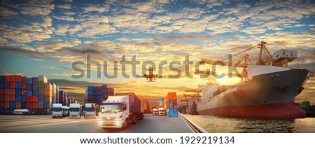 Container truck in ship port for business Logistics and transportation of Container Cargo ship and Cargo plane with working crane bridge in shipyard at sunrise, logistic import export and transport  Royalty-Free Stock Photo #1929219134