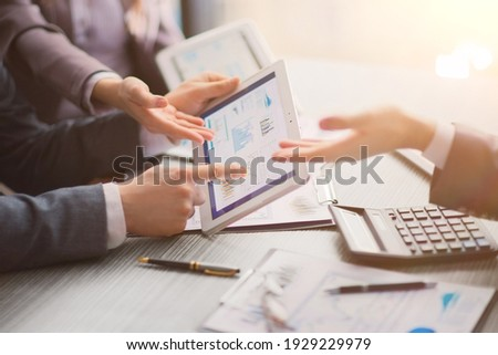 close up. business colleagues discussing financial documents. Royalty-Free Stock Photo #1929229979