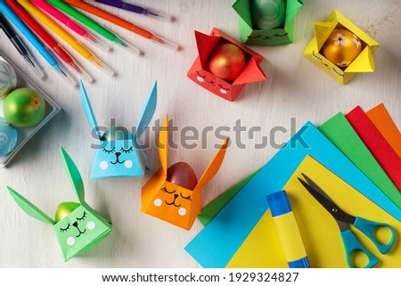DIY paper crafts for the Easter holiday. Origami paper Easter bunny - egg basket for Easter greetings. Hobbies at home. Self-employment and needlework. DIY concept. Step by step instruction Royalty-Free Stock Photo #1929324827