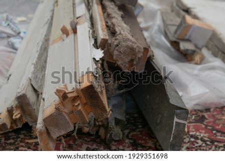 Construction garbage. Dismantled old window and sill. Royalty-Free Stock Photo #1929351698